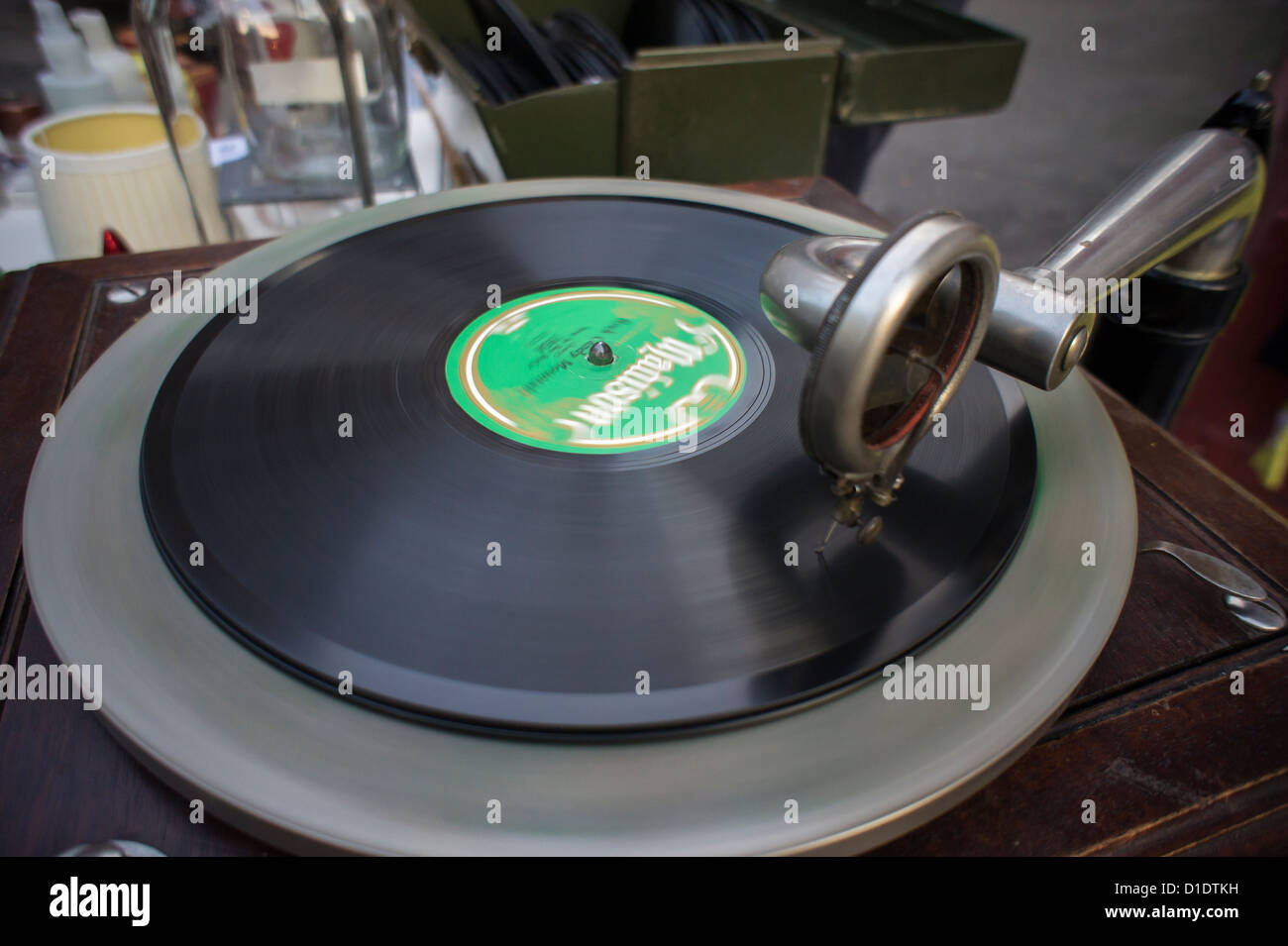 A record aficionado plays an antique 78 rpm record on an antique gramophone on New York - Stock Image