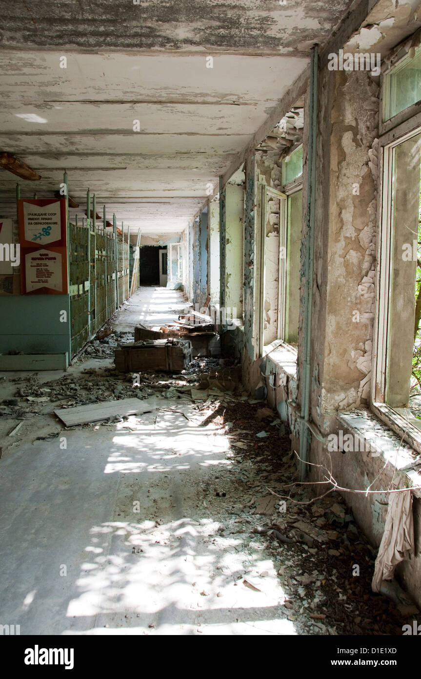 Chernobyl disaster results. This is corridor in abandoned school in small city Pripyat - Stock Image