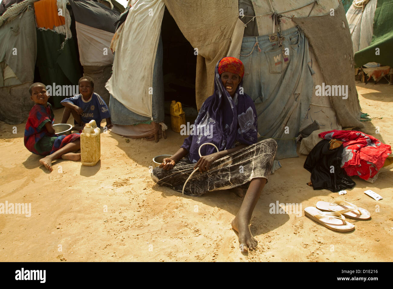 Sick woman and her children in front of a refugee tent Mogadishu Somalia. - Stock Image