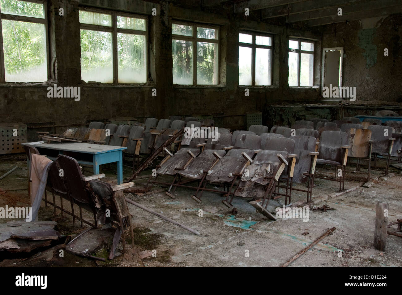 Chernobyl disaster results. This is conference hall in abandoned school in small city Pripyat - Stock Image