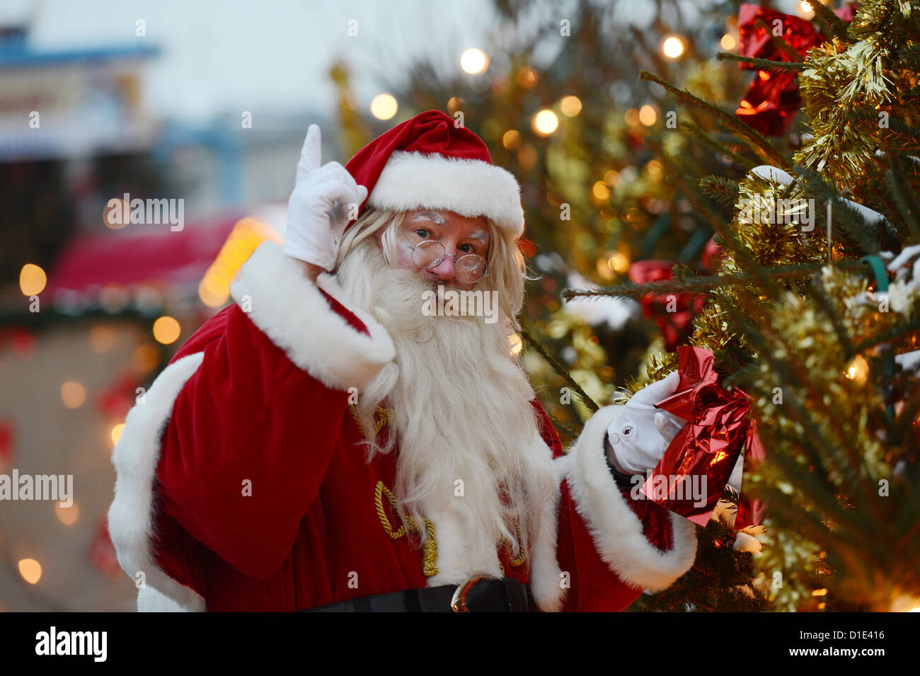 A Man Dressed Up Like Santa Claus Poses Next To Christmas Tree On The Nostalgic Market At Opernpalais In Berlin Germany 12 December 2012