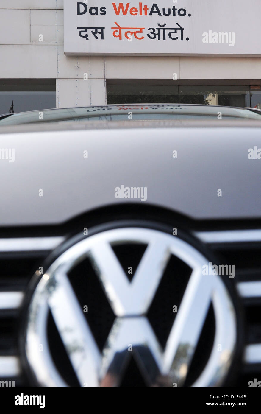 A Vw Passat Is Parked In Front Of A Vw Car Dealership In Jaipur
