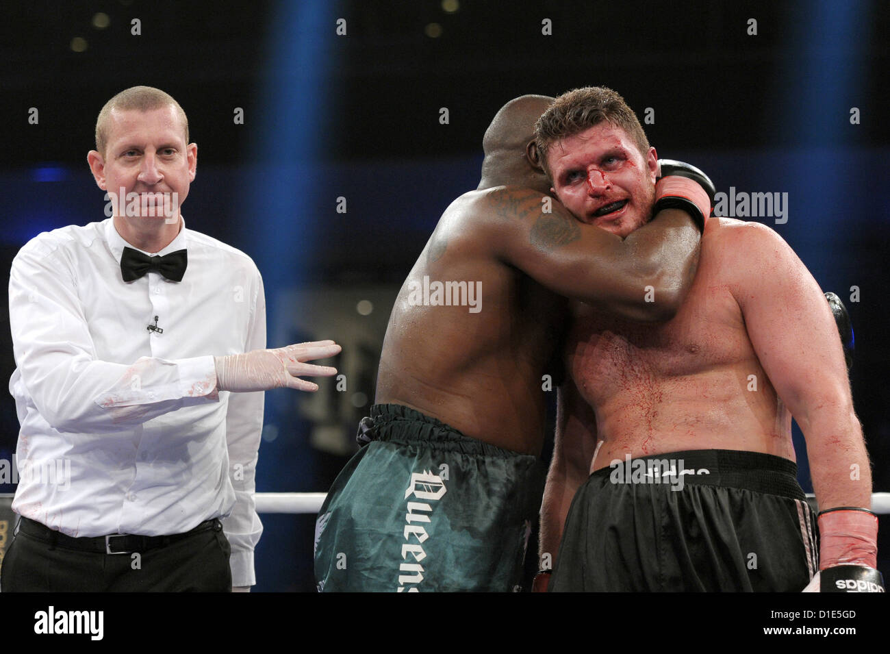 German boxer Edmund Gerber (L) and the Briton Michael Sprott gesture after their boxing match at the Arena Nuernberger Stock Photo