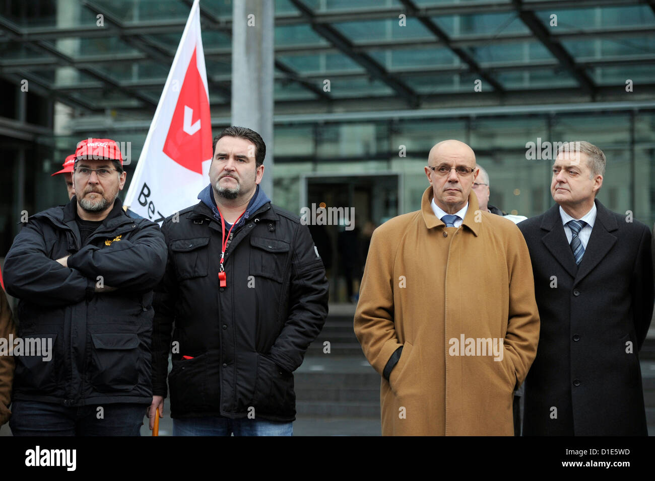 Board members Eberhard Klein (r) and Franz Sommerfeld (2-r) stand at the headquarters of DuMont while employees - Stock Image