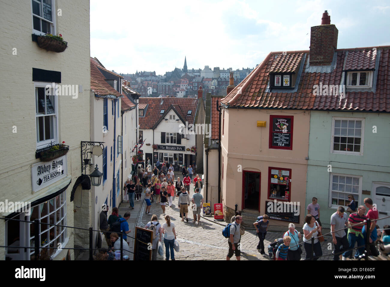 Tourists on the streets of Whitby on a summer day, Yorkshire, England, United Kingdom, Europe - Stock Image