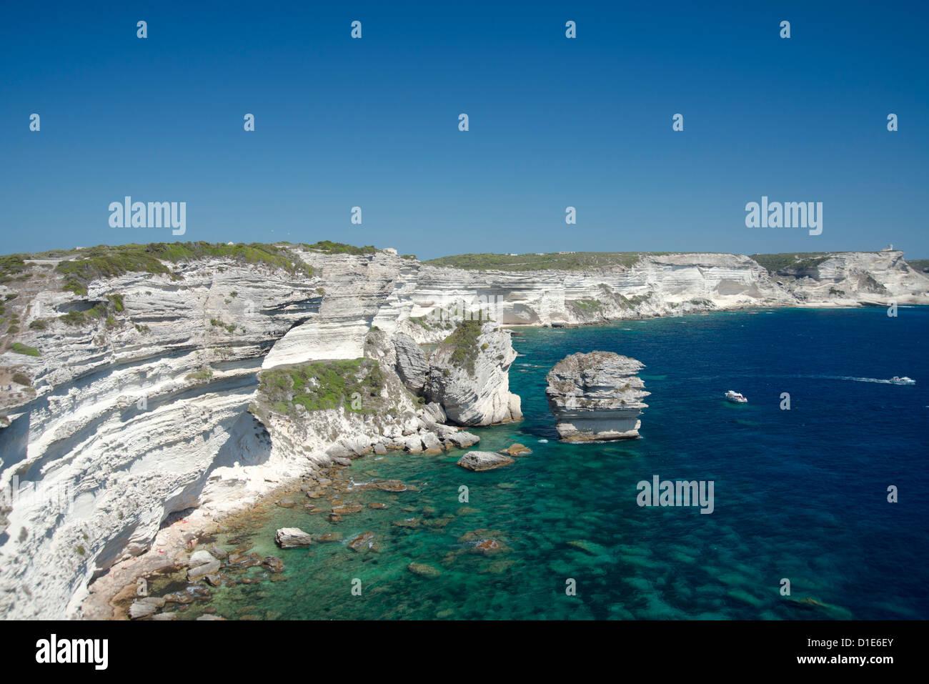 White limestone cliffs above emerald sea in Bonifacio, Corsica, France, Mediterranean, Europe - Stock Image