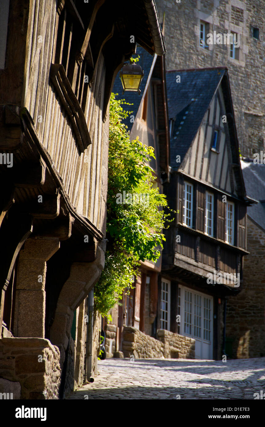 Medieval corbelled and half timbered mansions in cobbled street, Old Town, Dinan, Brittany, Cotes d'Armor, France, - Stock Image
