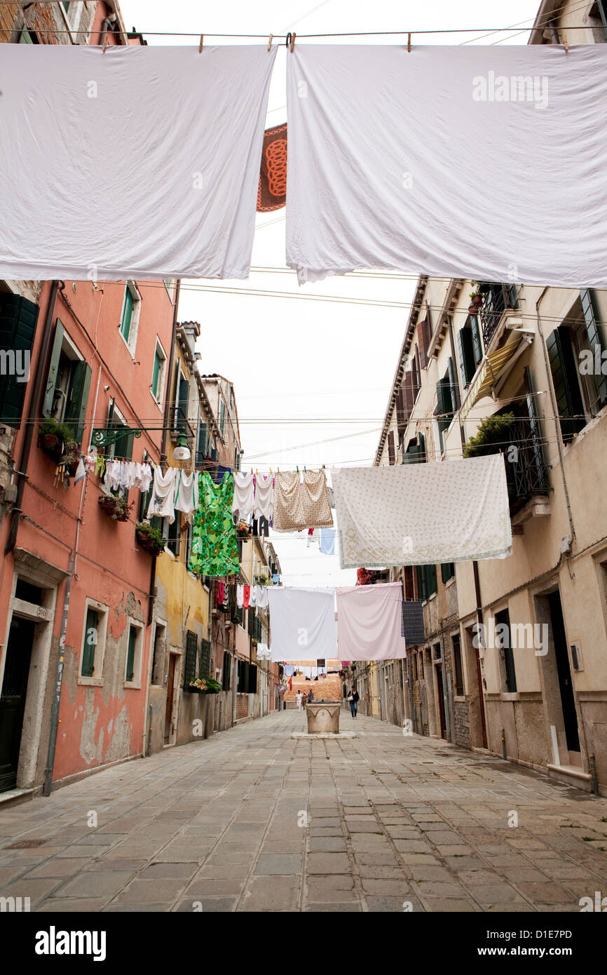 Washing line geometry in the streets of Castello, Venice, Veneto, Italy, Europe - Stock Image