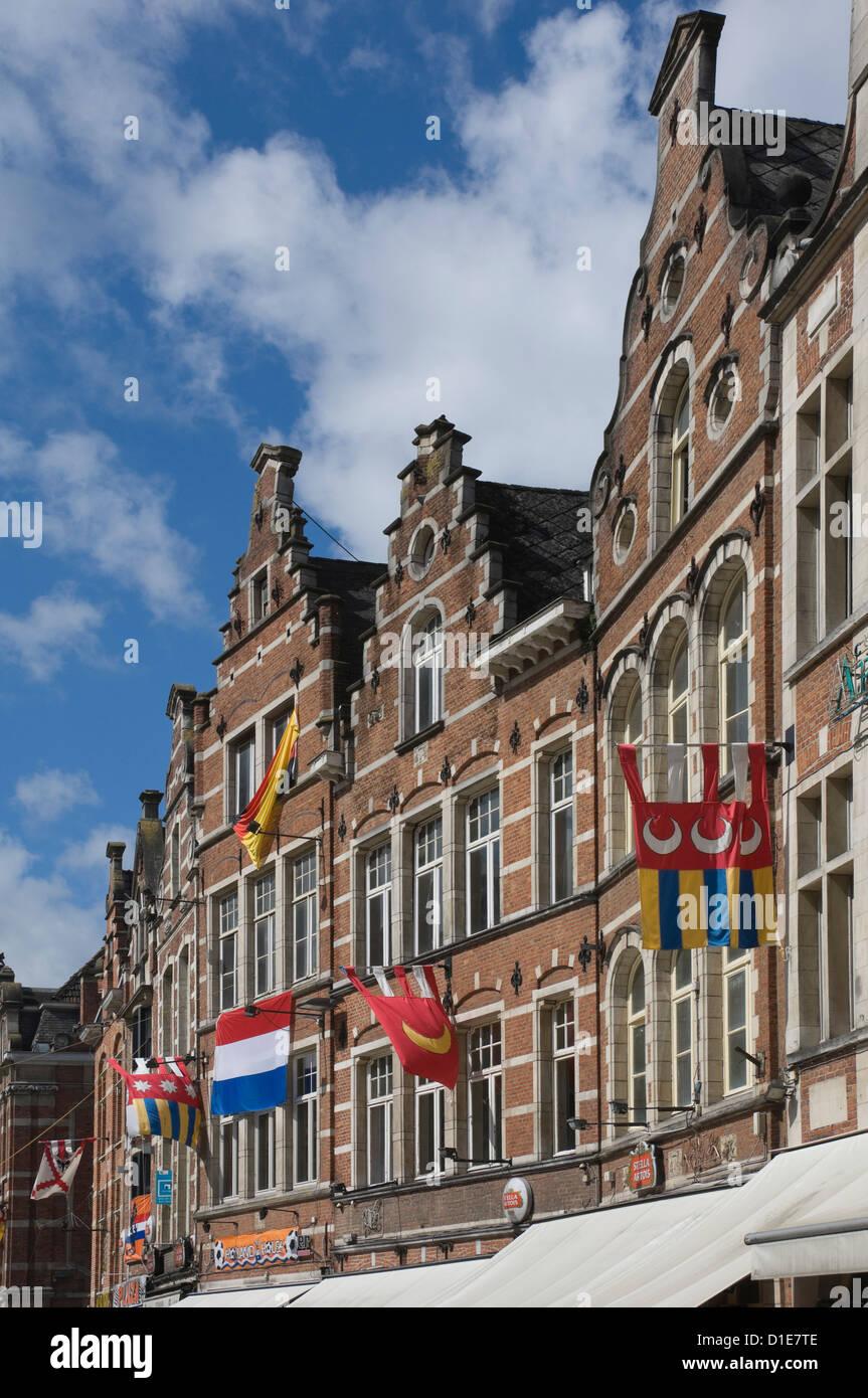 Traditional gabled facades decorated with heraldic banners, Oude Markt, Leuven, Belgium, Europe - Stock Image