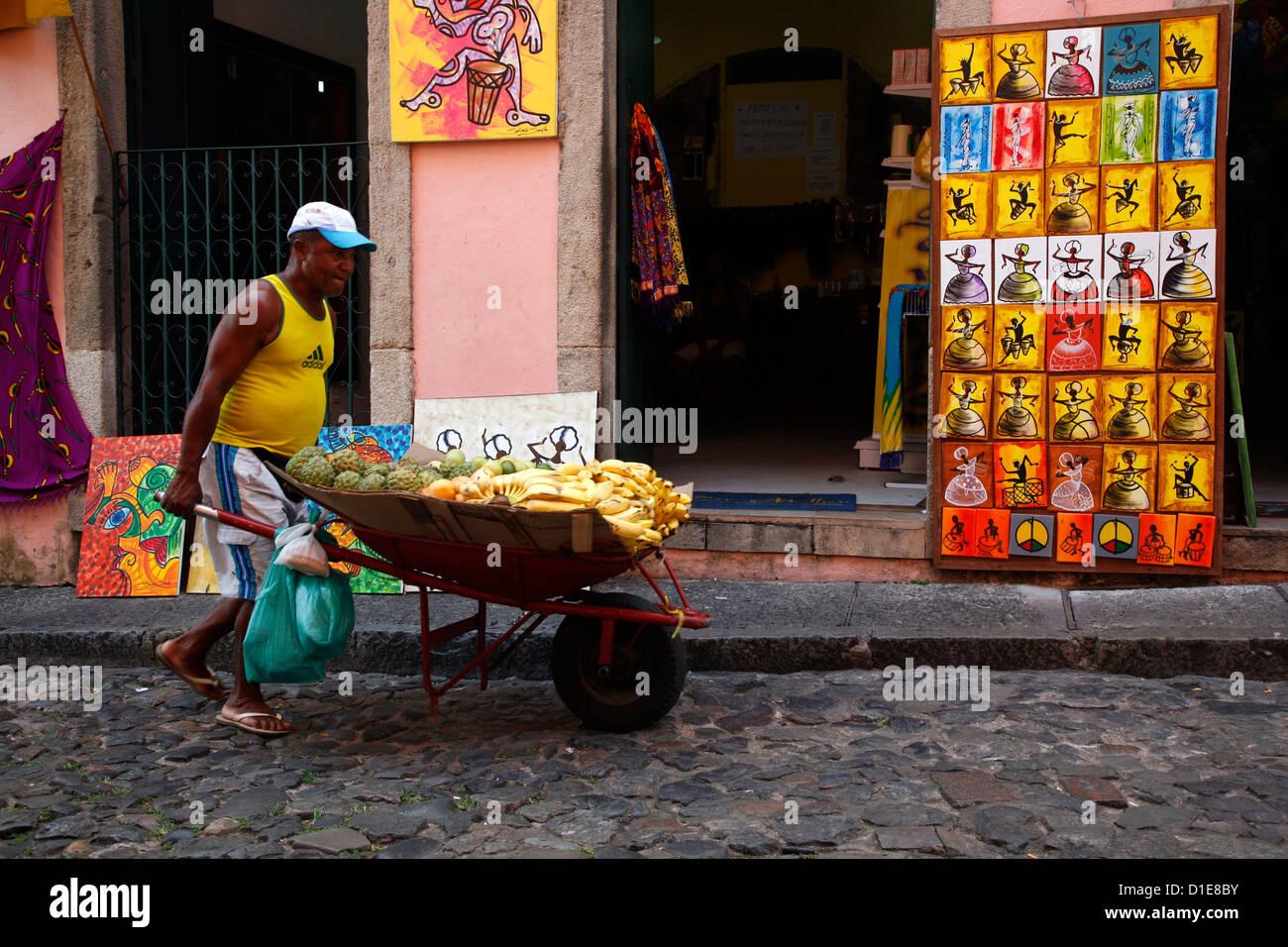 Fruit vendor in the cobbled streets of Largo de Pelourinho, Salvador, Bahia, Brazil, South America - Stock Image
