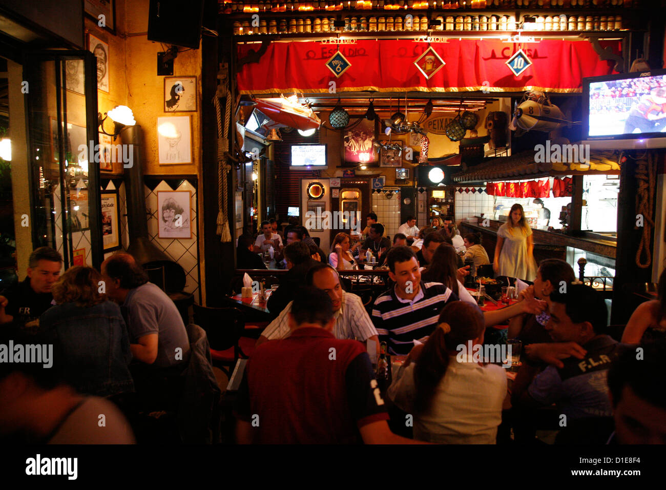 People in a restaurant in the Vila Madalena area known for its bars, restaurants and nighlife, Sao Paulo, Brazil, - Stock Image