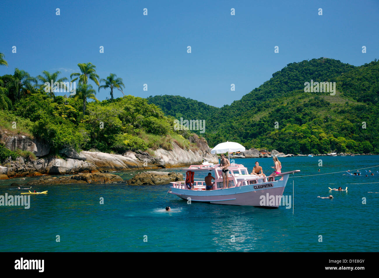 Tourist on a fishing boat cruising between the different beaches and islands around Parati, Rio de Janeiro State, - Stock Image