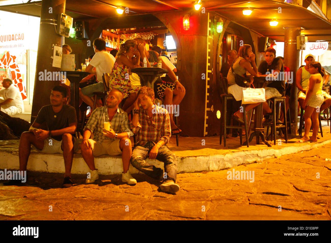 People at a bar on Rua Das Pedras, Buzios, Rio de Janeiro State, Brazil, South America - Stock Image