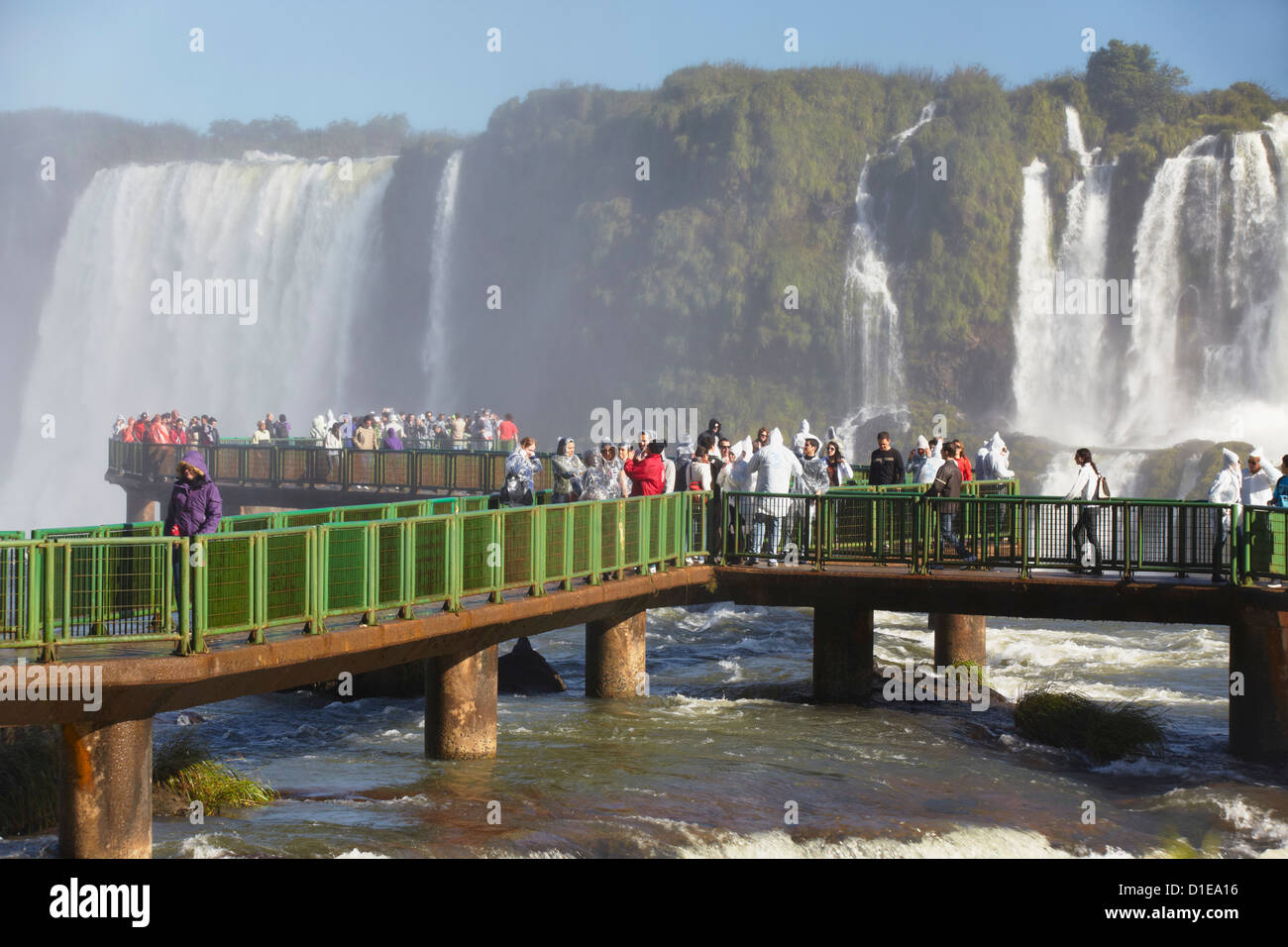 Tourists on walkway at Iguacu Falls, Iguacu National Park, UNESCO World Heritage Site, Parana, Brazil, South America - Stock Image