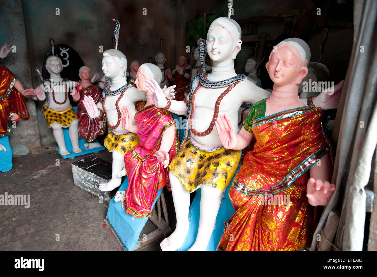 Finished, painted and dressed deities ready for offering at festival pujas, Kumartuli district, Kolkata, West Bengal, - Stock Image