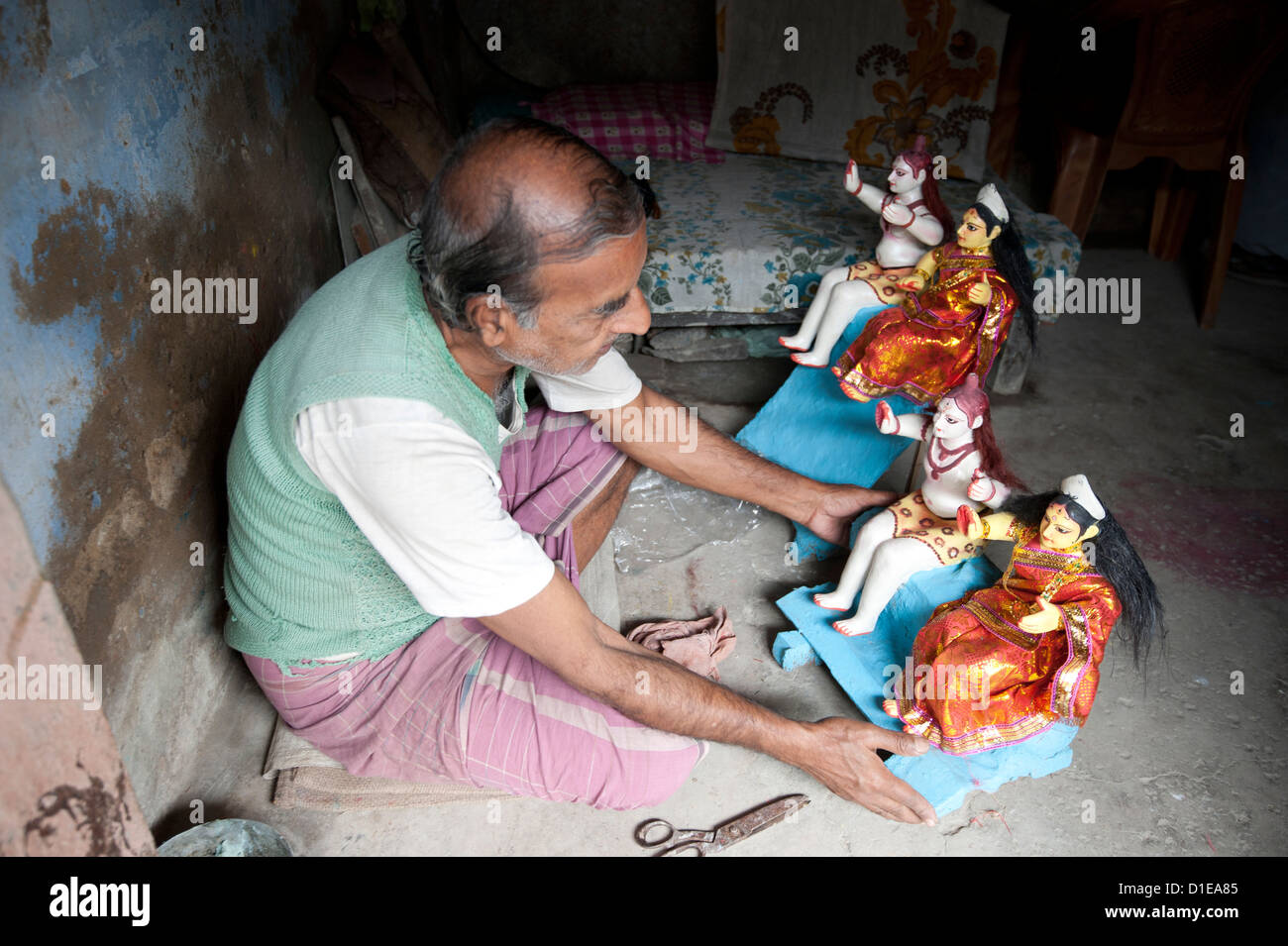 Sculpture with painted and dressed deities at festival pujas, Kumartuli district, Kolkata, West Bengal, India - Stock Image