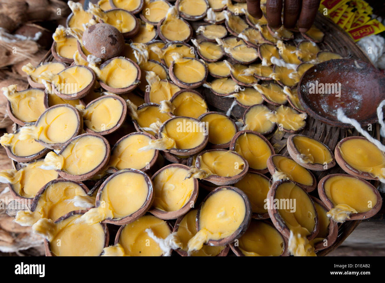 Oil lamps used for puja, with cotton wicks in terracotta pots, Bhubaneshwar, Orissa, India, Asia - Stock Image
