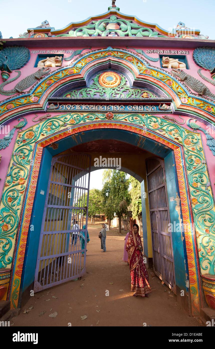 Ornately decorated entrance gateway to Joranda Hindu Mahima Dharma monastery, Joranda, Orissa, India, Asia - Stock Image