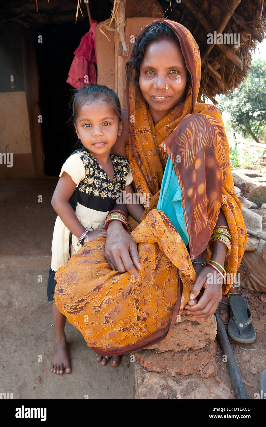 Mother and daughter, family of untouchable brass Dokhra worker in rural village, Orissa, India, Asia - Stock Image
