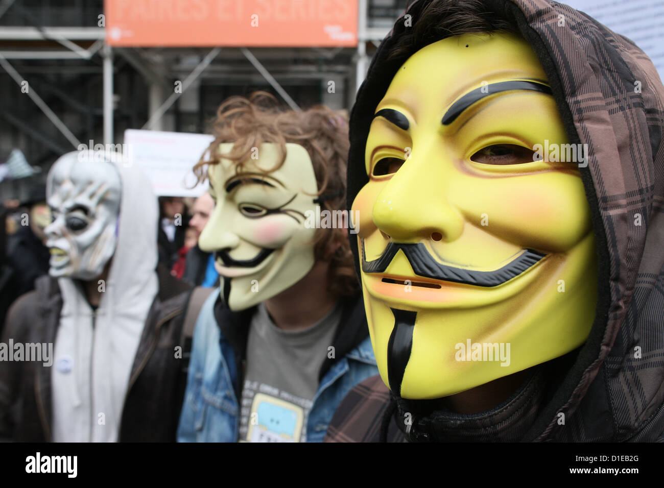 Protestors wearing Guy Fawkes masks of the Anonymous movement, based on a character in the film V for Vendetta, - Stock Image