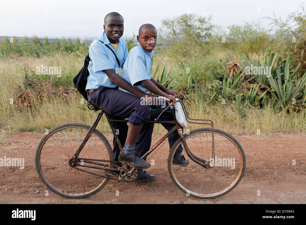 Schoolchildren on a bike, Embu, Kenya, East Africa, Africa - Stock Image