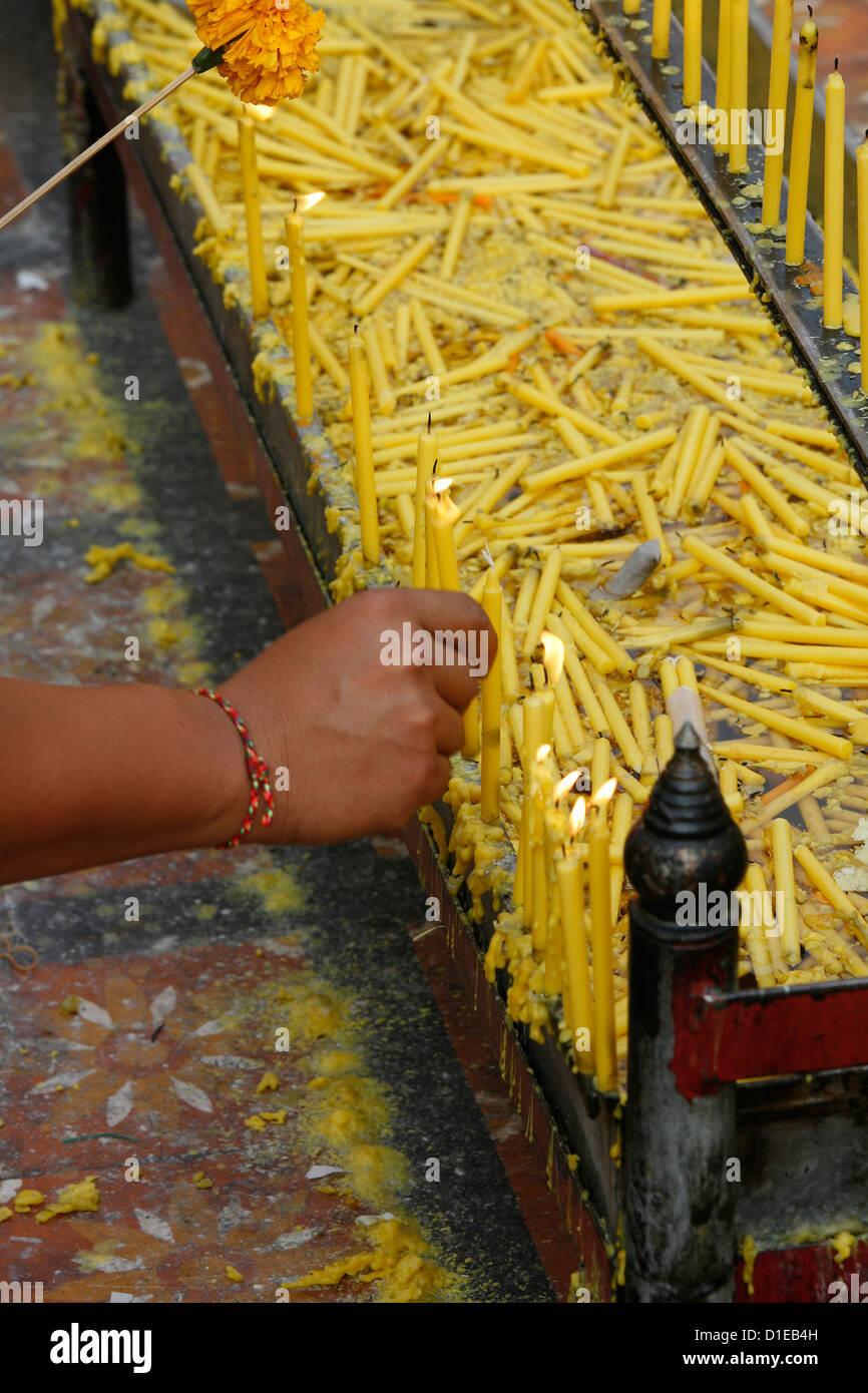 Lighting a candle in Doi Suthep, Chiang Mai, Thailand, Southeast Asia, Asia - Stock Image