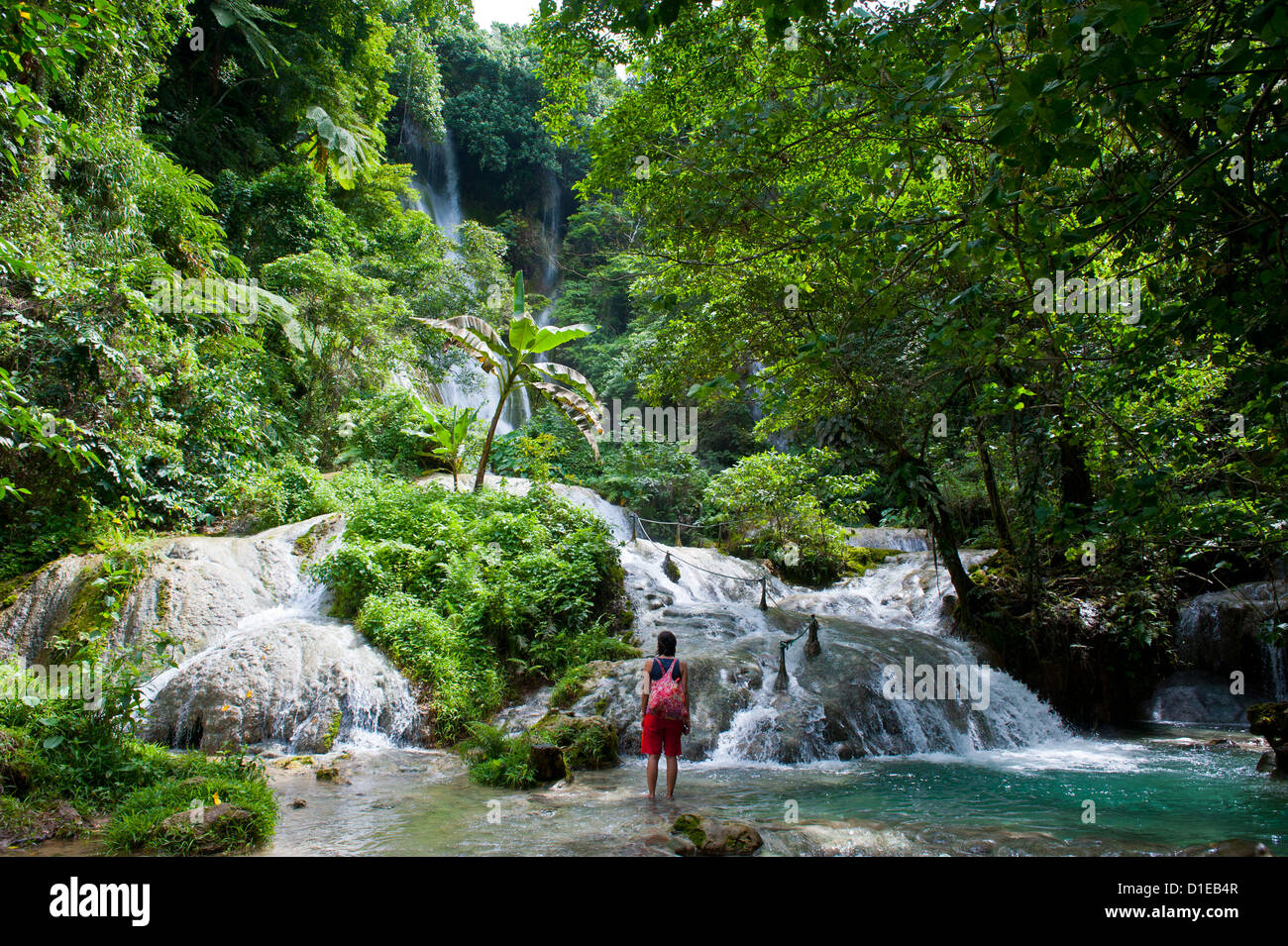 Woman looking at the beautiful Mele-Maat cascades in Port Vila, Island of Efate, Vanuatu, South Pacific, Pacific - Stock Image