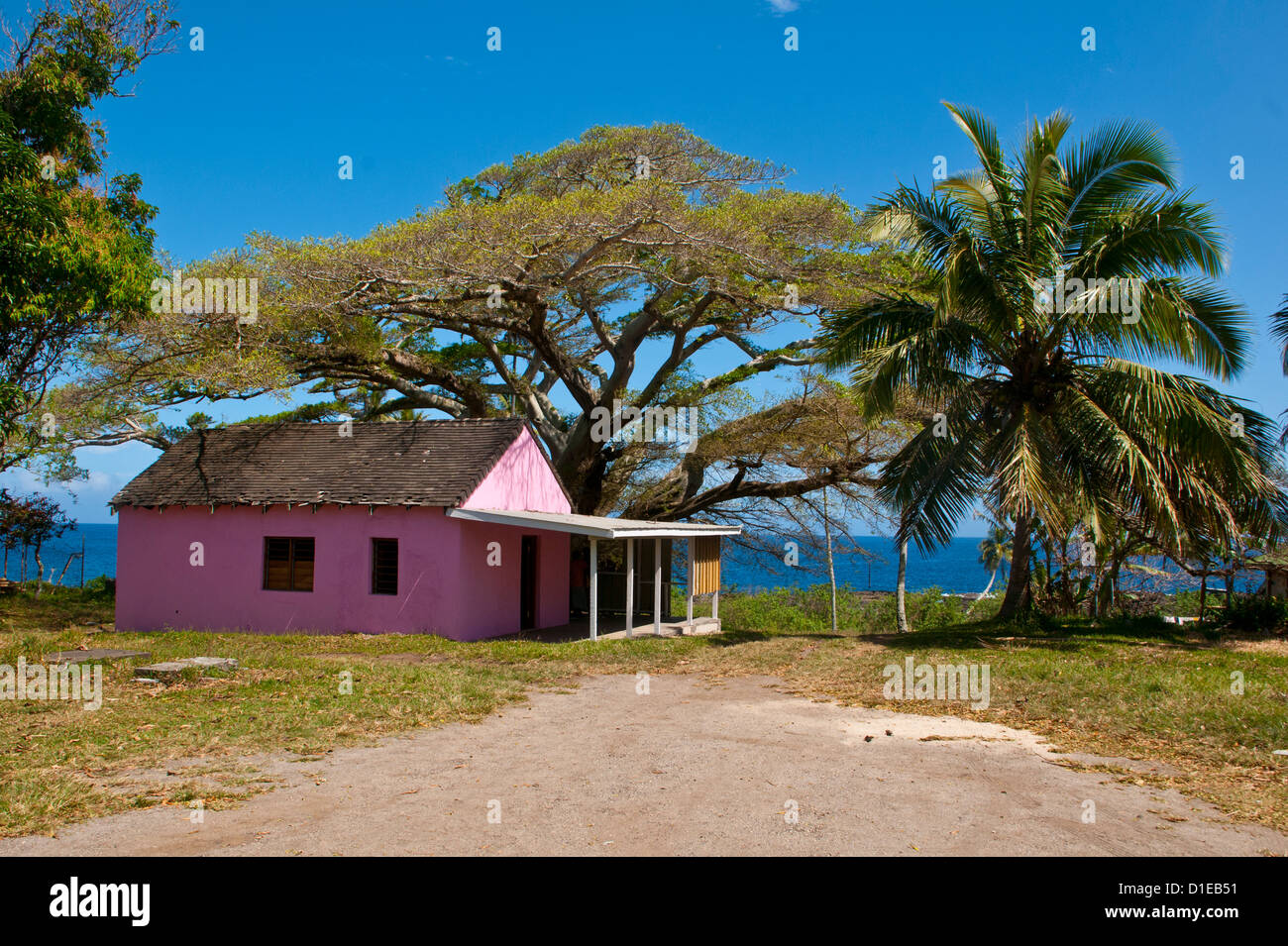 Pink town house in Lenakel capital of the Island of Tanna, Vanuatu, South Pacific, Pacific - Stock Image
