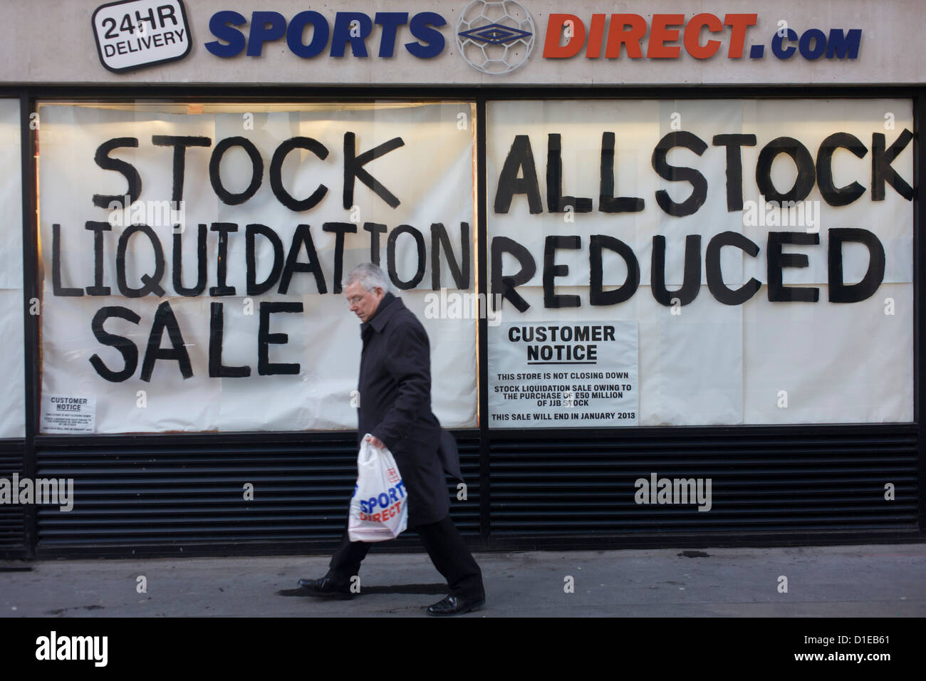 An all reduced sale of sports clothing supplier JJB.com stock, being sold by new buyer, Sports Direct shop in central - Stock Image