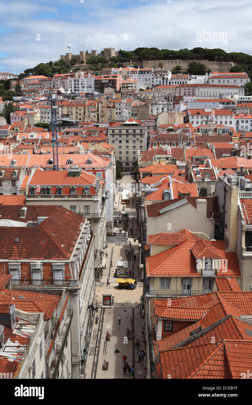 Castelo Sao Jorge looks over buildings of the central Baixa-Chiado, Baixa and Castelo districts of Lisbon, Portugal, - Stock Image