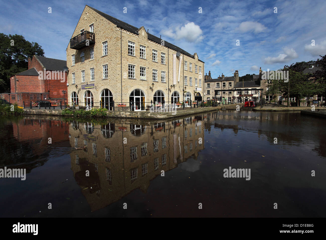 Buildings and the Rochdale Canal Dry Dock at Hedben Bridge, West Yorkshire, Yorkshire, England, United Kingdom, - Stock Image