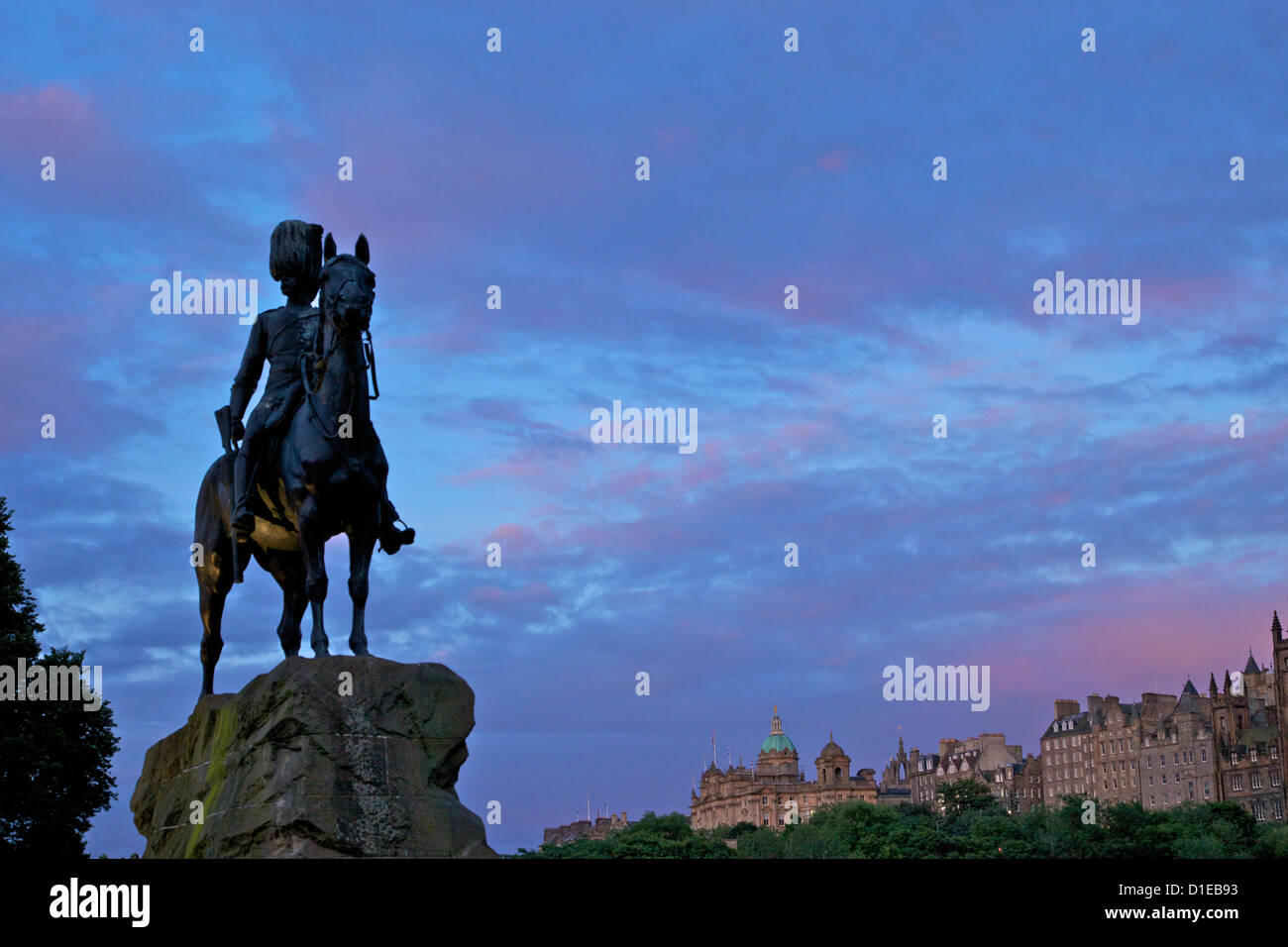 Royal Scots Greys Boer War memorial equestrian statue Princes Street, with the Royal Mile behind, Edinburgh, Scotland - Stock Image