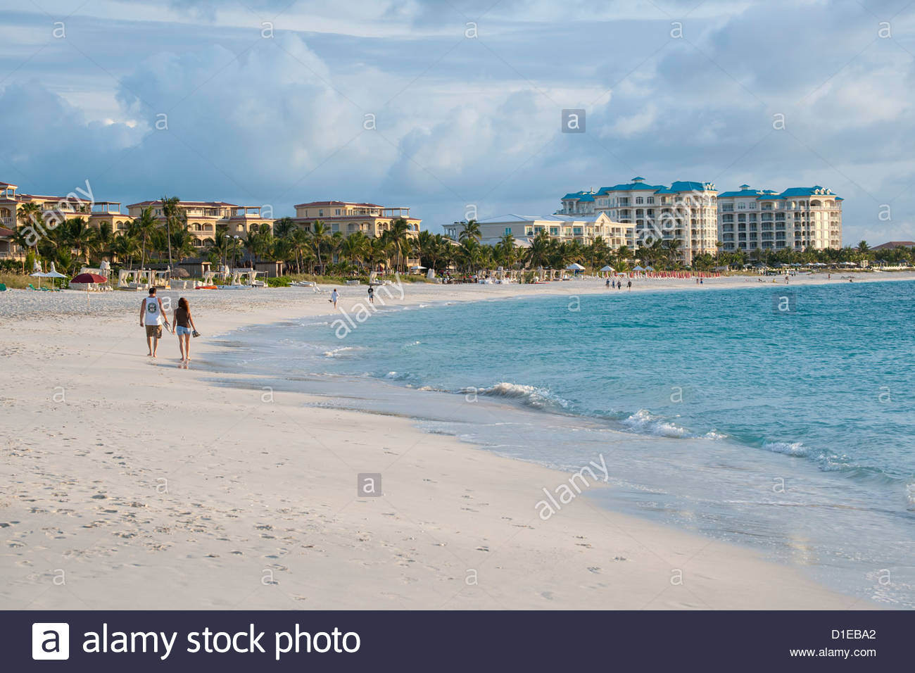 Stretch of hotels and palm trees along famous Grace Bay beach, Providenciales, Turks and Caicos Islands, West Indies, Stock Photo