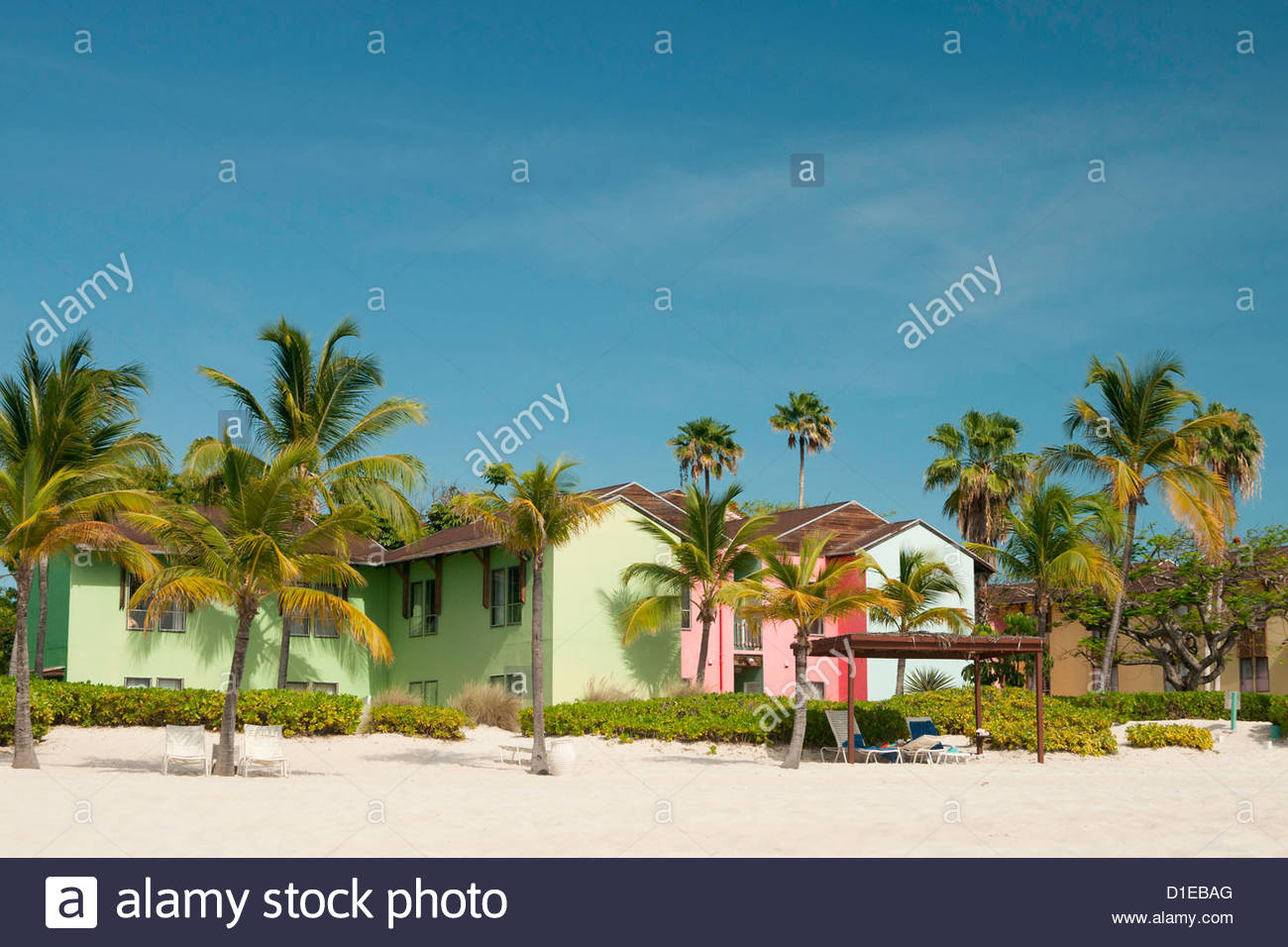 Pastel colored Caribbean homes on Grace Bay Beach, Providenciales, Turks and Caicos Islands, West Indies, Caribbean - Stock Image