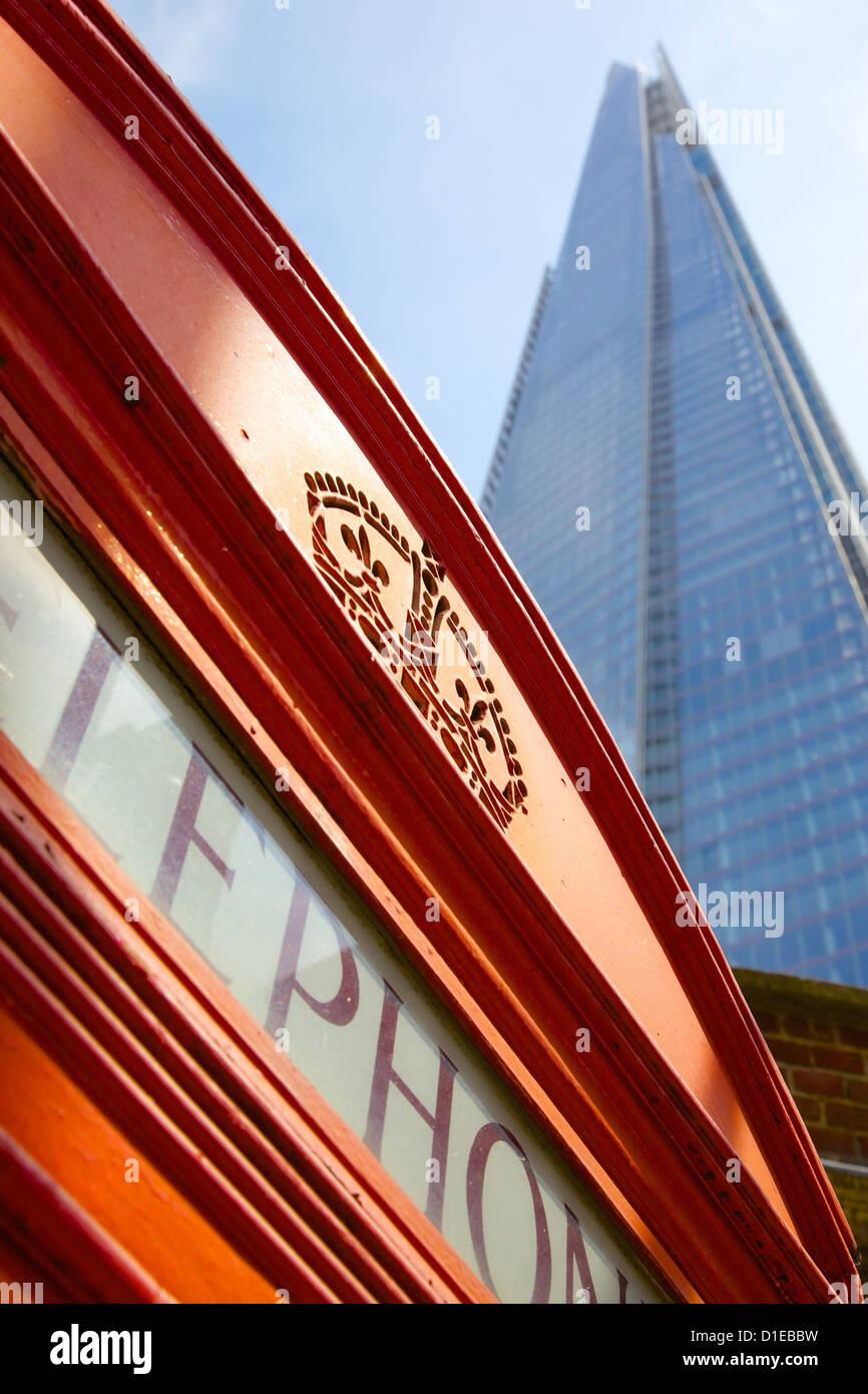 Red telephone box and The Shard, London, England, United Kingdom, Europe - Stock Image