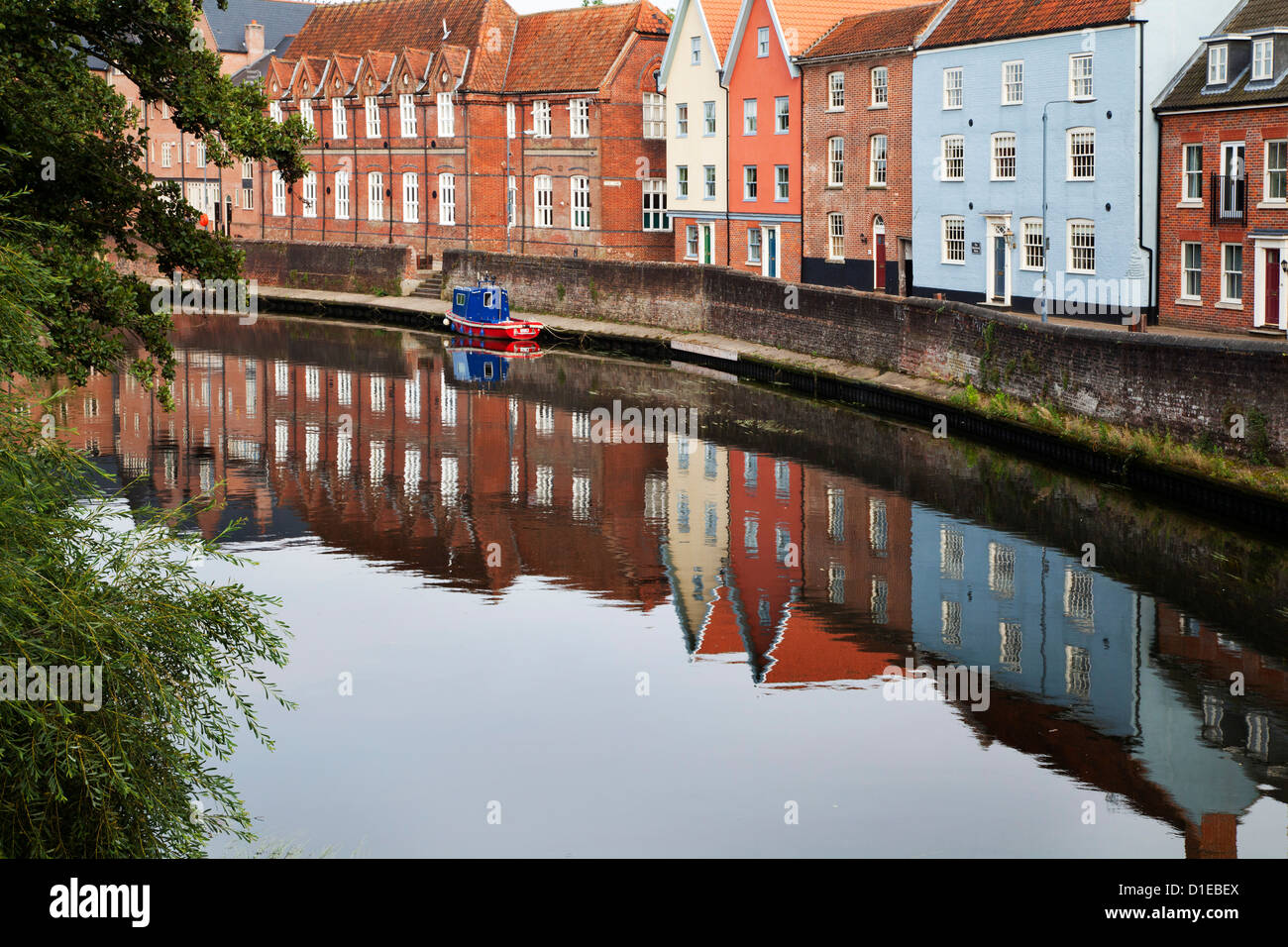 Quayside buildings reflected in the River Wensum, Norwich, Norfolk, England, United Kingdom, Europe - Stock Image