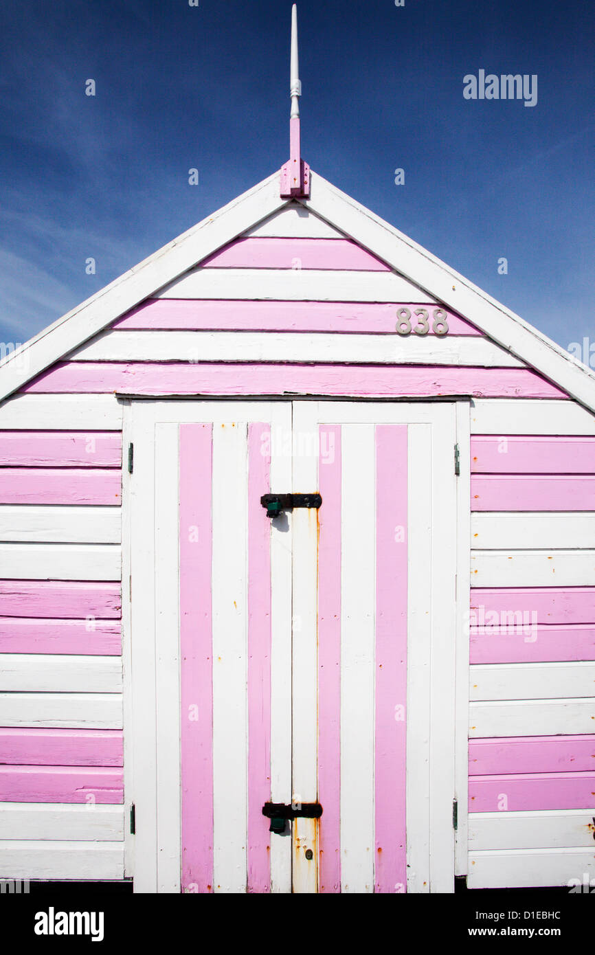 Pink And White Striped Beach Hut Felixstowe Suffolk England Stock