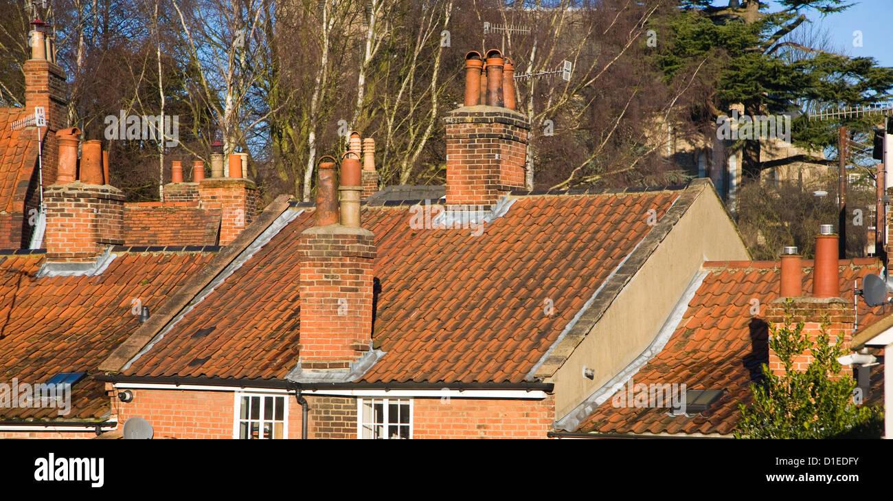 Pan tiled roofs house chimneys, Woodbridge, Suffolk, England - Stock Image