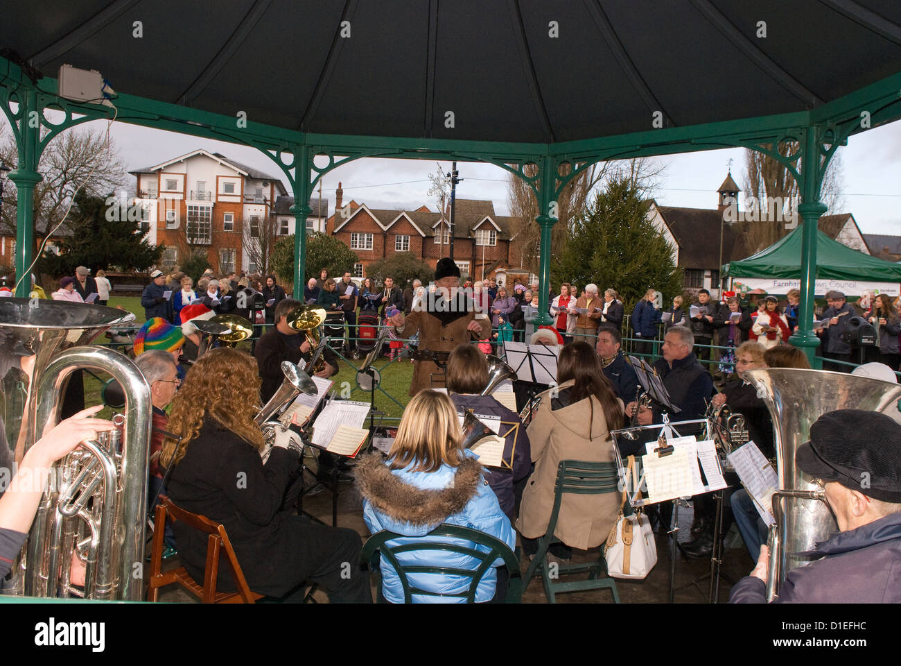 Carol service at the bandstand at christmas time, Farnham, Surrey, UK. - Stock Image