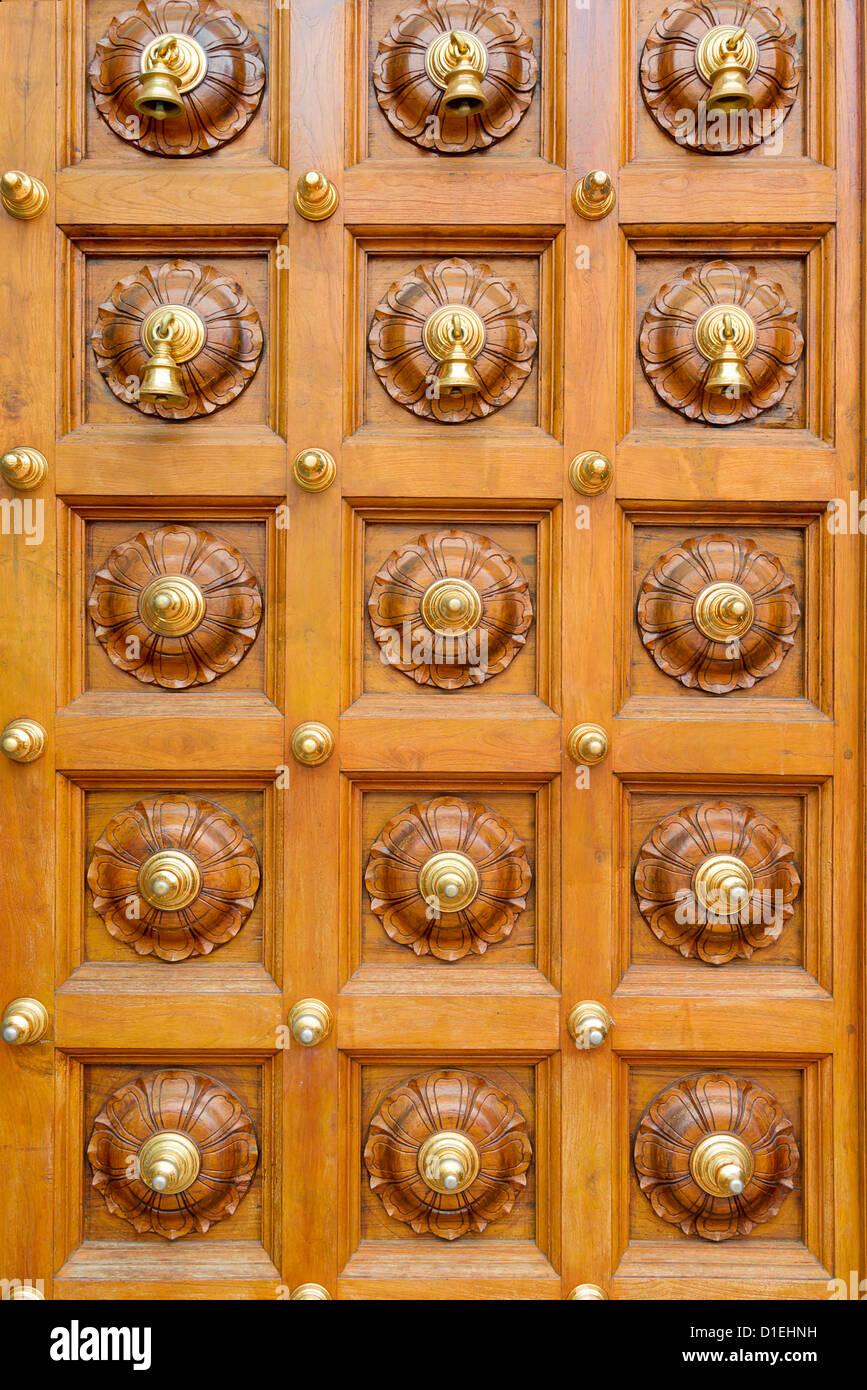 Wooden Temple Door With Bells In Hindu Temple