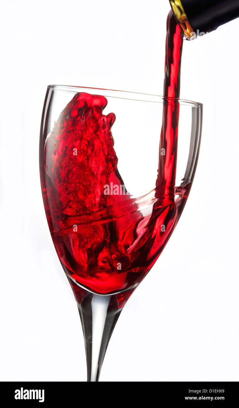 Red wine being poured into a glass Stock Photo
