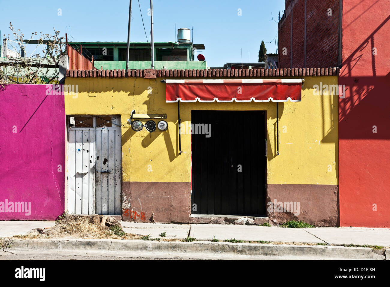 streetscape buildings painted with bright picturesque vivid Mexican ...