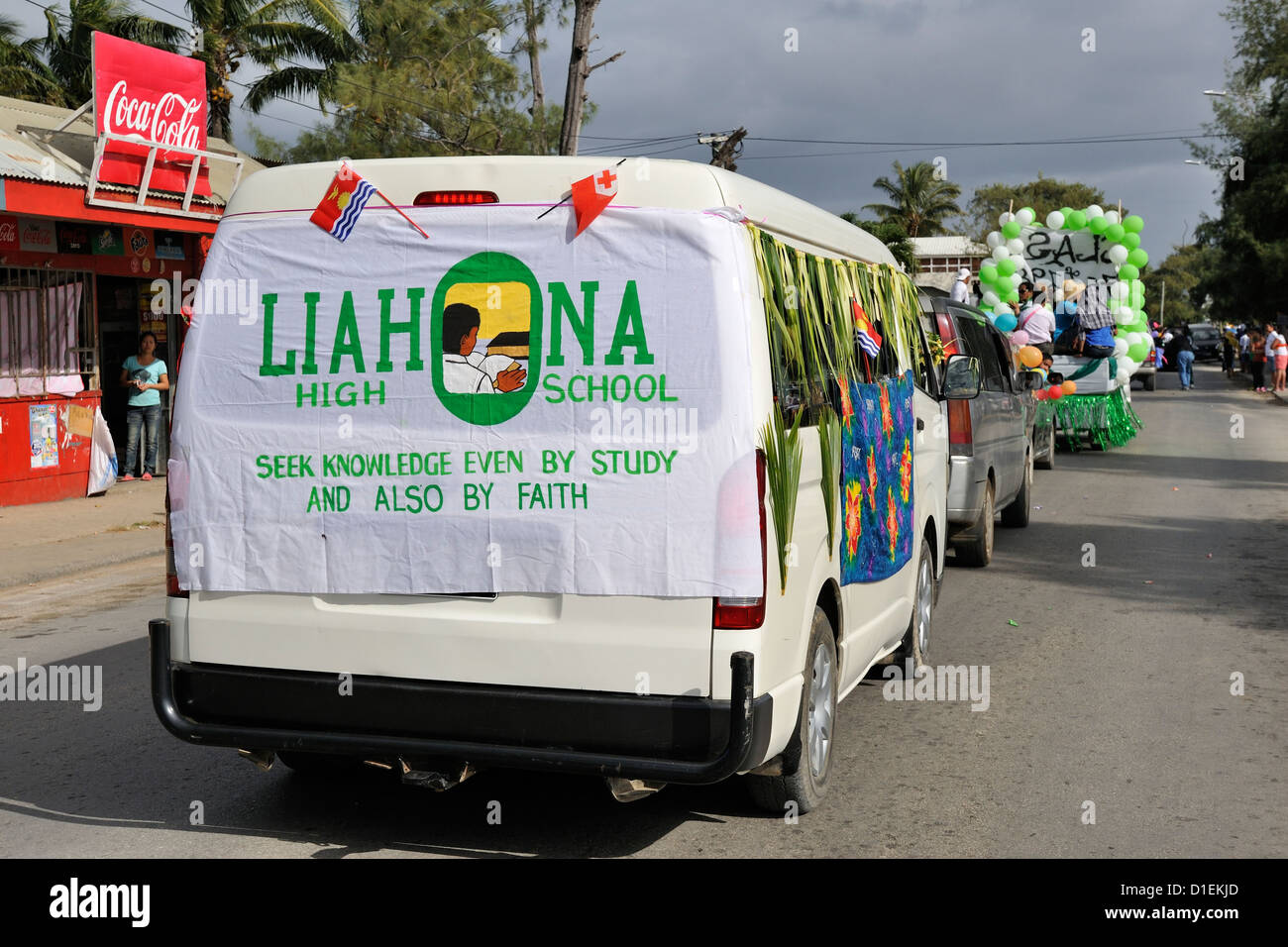 Liahona High School flag on minibus in the Float Parade on the first morning - July 16 - of the 2012 Heilala Festival. - Stock Image