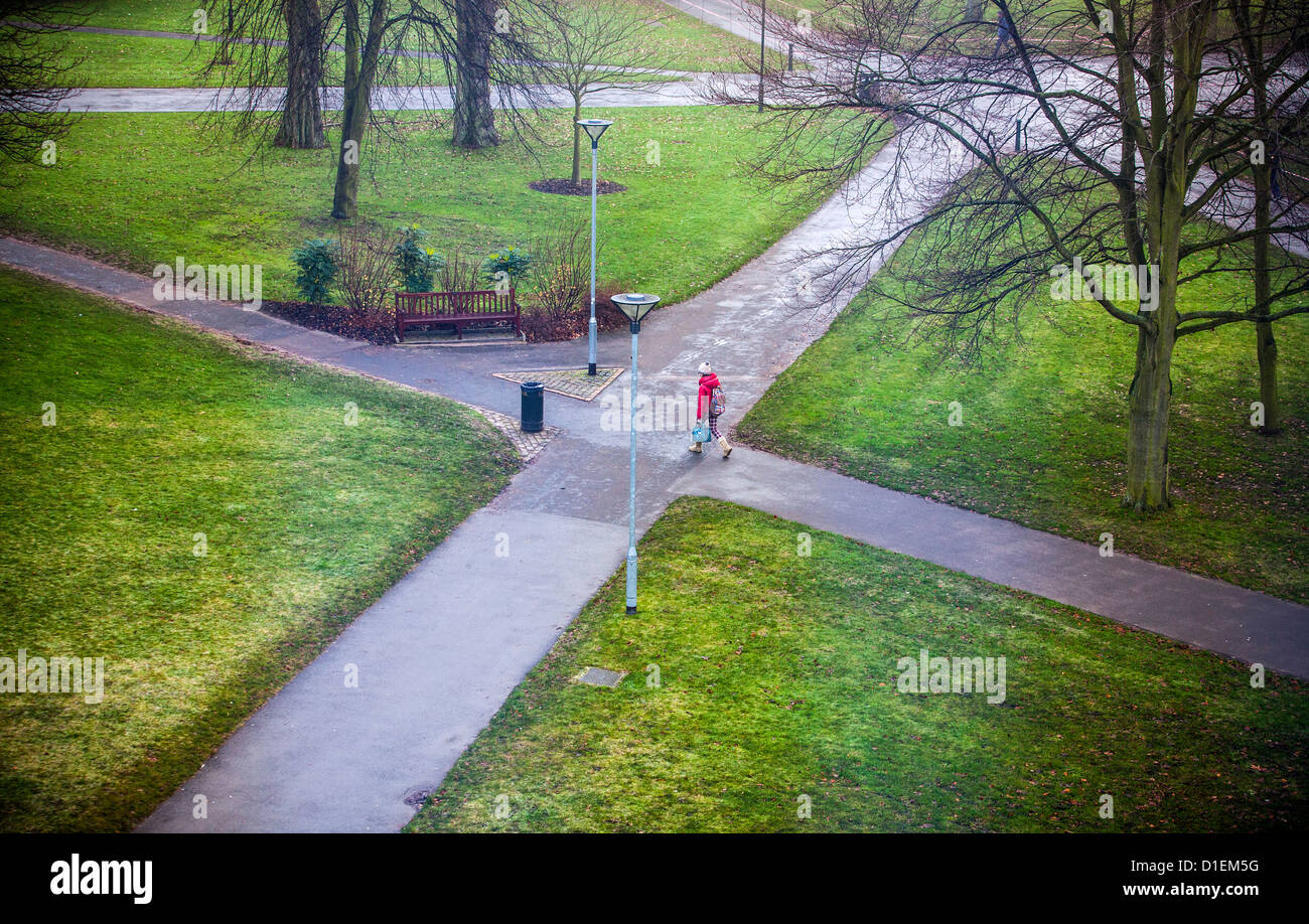 A lone student at a 'crossroads' at University of Birmingham campus, UK. - Stock Image