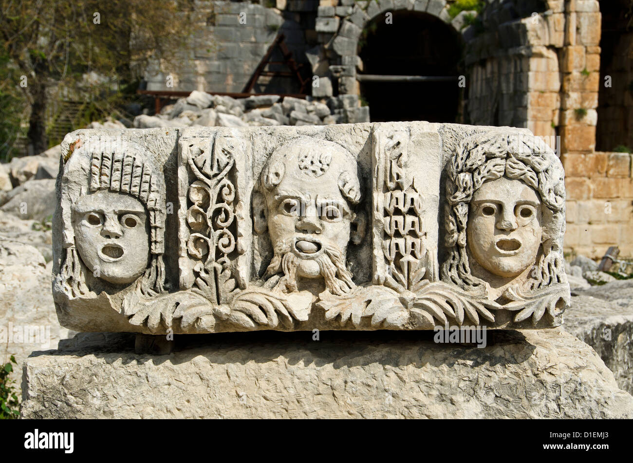 Antique theater masks made of stone in Myra, Turkey - Stock Image