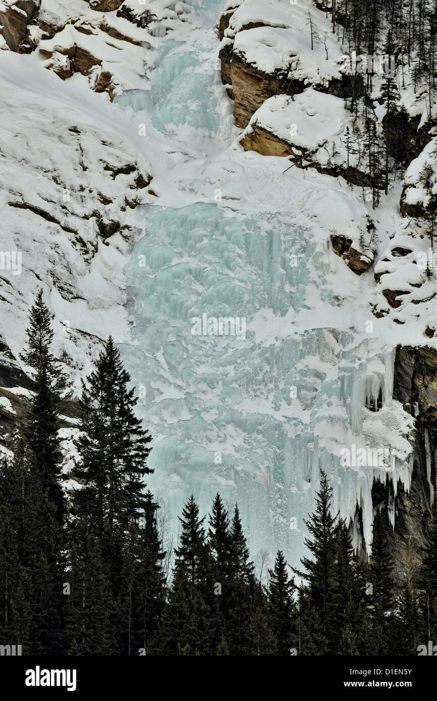 Frozen waterfall on Mt. Stephen, above the Kicking Horse River, Yoho National Park, BC, Canada - Stock Image