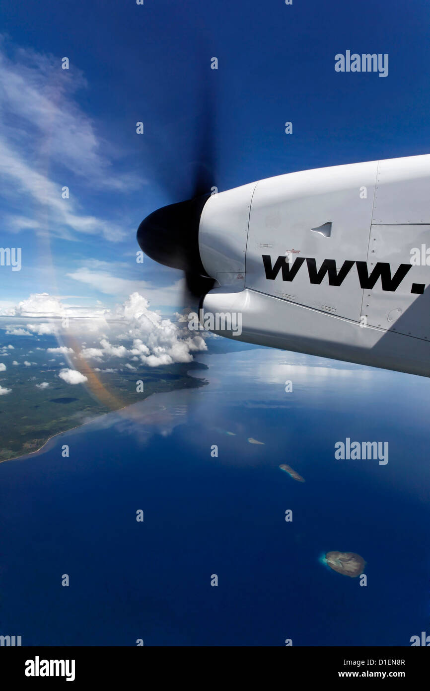 Propeller plane above islands of Papua New Guinea - Stock Image