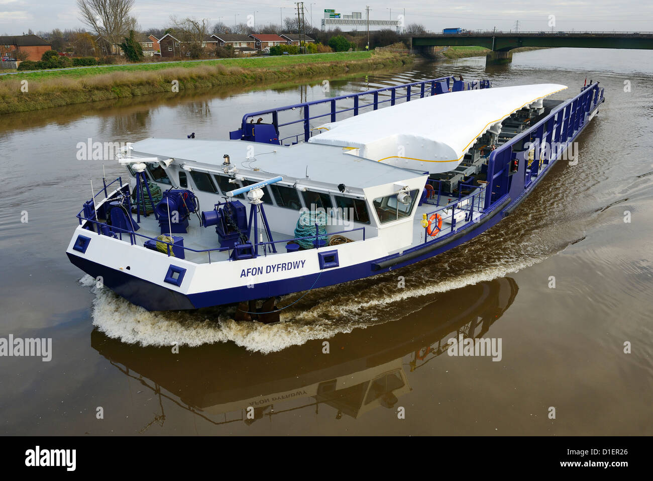 The Airbus A380 wing barge makes the journey from the Broughton factory along the River Dee to Mostyn Docks - Stock Image