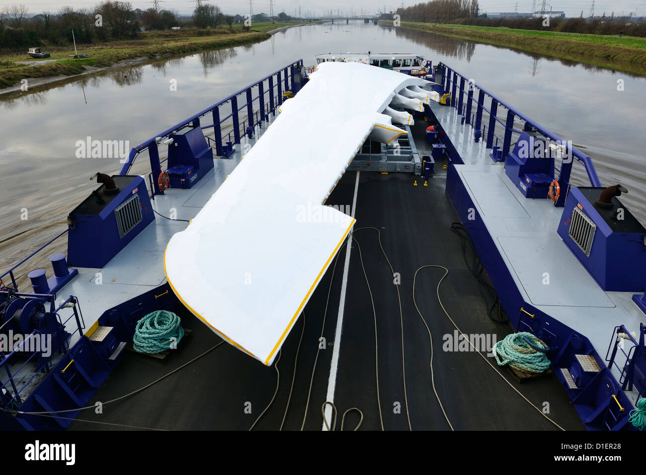 The Airbus A380 wing barge makes the journey from the Broughton factory along the River Dee to Mostyn Docks Stock Photo