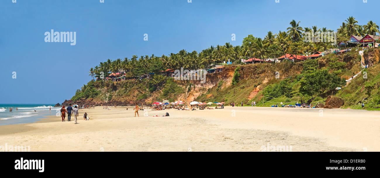 Horizontal panoramic (3 picture stitch) view along Papanasam beach at Varkala, Kerala. - Stock Image